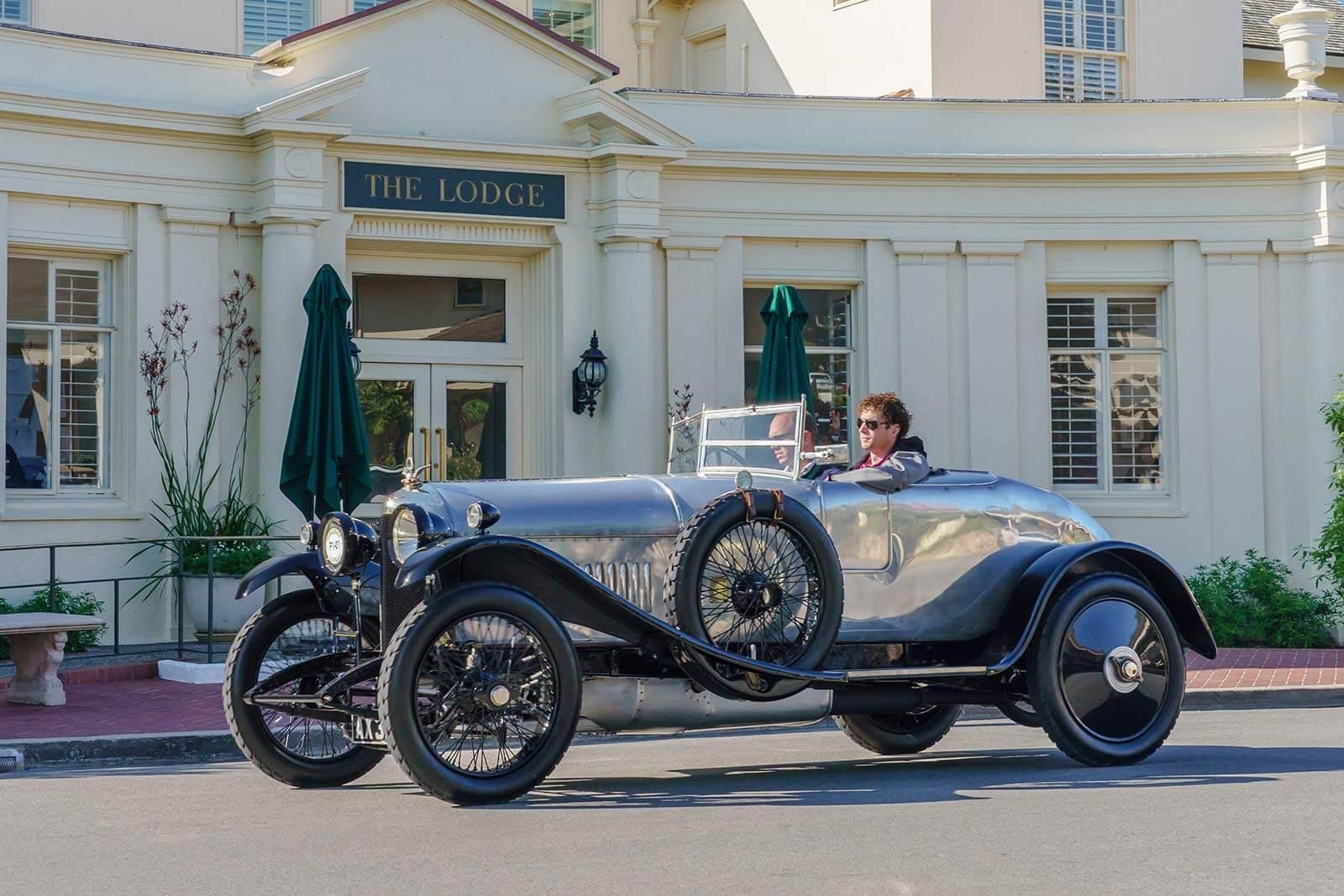 The Pebble Beach Tour d'Elegance drives past The Lodge at Pebble Beach.